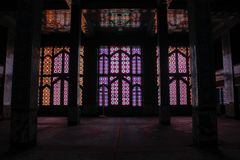 Stained glass windows and columns inside the mosque stock photography