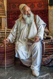 ISFAHAN, IRAN - May, 09: Sufi at the market in Isfahan, Iran on Royalty Free Stock Photo