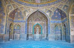 Interior of Seyed Mosque, Isfahan, Iran. ISFAHAN, IRAN - OCTOBER 21, 2017: Interior of richly decorated Seyed Mosque with masterpiece tiling, relief mihrab stock image