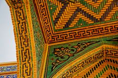 Isfahan Old Mosque detail. ISFAHAN, IRAN - MAY 8, 2015: Detail of the tile mosaic at the entrance of the Taj al Molk Jameh mosque one of the oldest in Iran Stock Photos