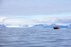 Isfjord in Svalbard in Spitsbergen. Norway. Beautiful bay on the background of snowy mountains stock image