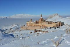 Ishak Pasha Palace in winter. Ishak Pasha Palace Turkey against snow covered mountains land blue sky background Royalty Free Stock Photography