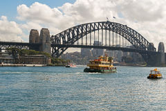Ishburn ferry and other boats crossing under Sydney Harbour Brid Stock Photo