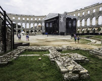 Iside of Amphitheater 1st century AD in Pula. Street stage. People, Stones and street stage stock photo