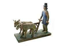 Isidore the ploughman. Lithuanian version of Isidore the ploughman. Wooden sculpture of unknown artist of XIX century (folk art stock photography
