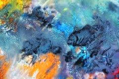 Iskall bakgrund för blå kontrast för orange guling och att måla vattenfärgbakgrund som målar abstrakta färger arkivfoton