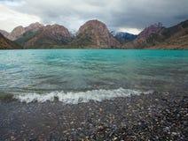 Iskander kul lake in rocky landscape in the Fan Mountains Stock Photo