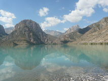 Iskanderkul lake in. Summer day at the lake Iskanderkul in Tajikistan Royalty Free Stock Photo