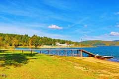 "Iskar Lake pier Bulgaria. Pier at Iskar Lake.The Iskar Reservoir-язовир ""Искър"" is the largest reservoir in stock photography"