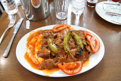 Iskender kababs in tomato sauce Stock Photography