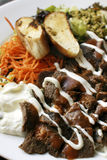 Iskender kebab一个普遍的土耳其盘 免版税库存照片