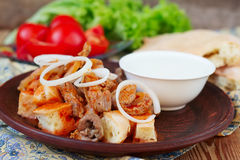 Iskender kebab - traditional turkish food Stock Photography