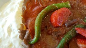 Iskender kebap. İskender kebap & x28;Alexander Kebab& x29; is one of the most famous meat foods of northwestern Turkey and takes its name from its inventor Royalty Free Stock Photos