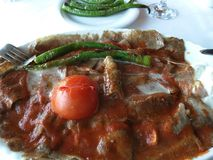 Iskender, translated as Alexander the Great Kebab is a well known ultra high caloric gourmet Turkish dish. Of Bursa made from high quality beef and typically stock photo