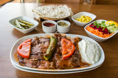 Iskender / Turkish Traditional Food. Made with meat yoghurt and fried bread royalty free stock photography