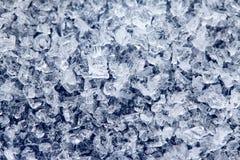 Iskristaller på en mörk kulör bakgrund Royaltyfria Foton