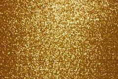 Iskrzasty złoty cekin tkaniny tło obraz stock