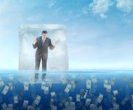 Iskub med en affärsman som svävar i havet royaltyfria foton