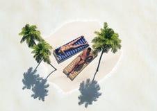 Isla con las palmeras y la gente Imagen de archivo libre de regalías