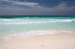 Isla Cozumel Beach. Crystal clear turquoise ocean waves crushing on a sandy beach. Isla Cozumel. Mexico Stock Photography