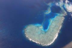 Isla del Fijian en la forma de un J Fotografía de archivo