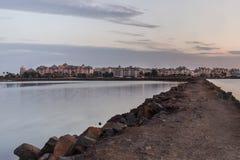 Isla del Moral on the horizon. Isla Moral on the horizon seen from Isla Cristina on Spain Royalty Free Stock Image