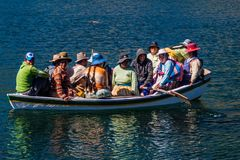 Local native people on a boat. ISLA DEL SOL, BOLIVIA - MAY 12, 2015: Local native people on a boat at Isla del Sol Island of the Sun in Titicaca lake, Bolivia royalty free stock image