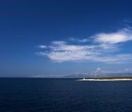 Isla en el mar adriático con el faro Fotografía de archivo libre de regalías