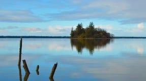 Isla en un lago Imagen de archivo libre de regalías