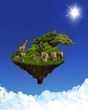 Isla flotante con los animales Fotografía de archivo