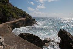 Isla Mujeres ö - Punta Sur punkt kallade också Acantilado del Amanecer Klippa av gryningen Royaltyfri Bild