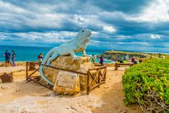 ISLA MUJERES - JANUARY 10, 2018: Outdoor view of a stoned statue in for of a shark whale located at outdoors in the. Streets of the city in Isla Mujeres, Mexico stock photo