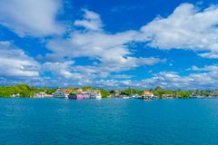 ISLA MUJERES, MEXICO, JANUARY 10, 2018: Astonishing outdoor view of many ships and some buildings in the horizont in the. Beach Isla Mujeres in caribbean sea Royalty Free Stock Photos