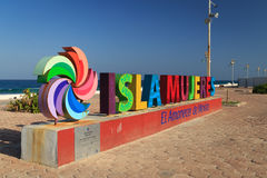 Isla Mujeres Sign. Isla Mujeres is spelled out in bright colors along the ocean on Isla Mujeres, Mexico Royalty Free Stock Photo