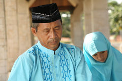 Islam, Father and Child  Praying Stock Images