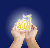 Islam. Hands of man praying to allah god of Islam on blue background.The words spell is Allah means the God of Islam royalty free stock images