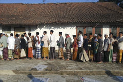 ISLAM IN INDONESIA. Muslims gather after the prayer of Eid El-Fitri in Banjarnegara, Java, Indonesia. Islam is the dominant religion in Indonesia, which also has Stock Image