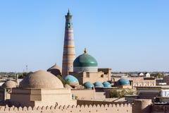 Islam Khodja Minaret and mosque - Khiva, Uzbekistan. Islam Khoja Minaret and moque in Itchan Kala, the inner town of the city of Khiva - Uzbekistan Stock Photography