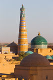 Islam Khodja Minaret and Mosque in Khiva, Uzbekistan. View of the Islam Khodja Minaret and Mosque from the watchtower of the Khuna Ark, the fortress of Khiva, in royalty free stock photography