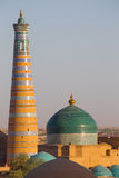 Islam Khodja Minaret and Mosque in Khiva, Uzbekistan. View of the Islam Khodja Minaret and Mosque from the watchtower of the Khuna Ark, the fortress of Khiva, in stock image
