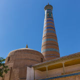 Islam Khodja Minaret and Mosque in Khiva, Uzbekistan. View of the Islam Khodja Minaret and Mosque from the watchtower of the Khuna Ark, the fortress of Khiva, in royalty free stock photo