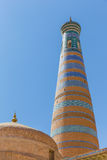 Islam Khodja Minaret and Mosque in Khiva, Uzbekistan. View of the Islam Khodja Minaret and Mosque from the watchtower of the Khuna Ark, the fortress of Khiva, in royalty free stock photos