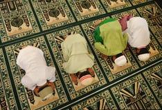 Islam Kids Praying, Ramadan. Muslim kids praying at Islamic school Royalty Free Stock Image
