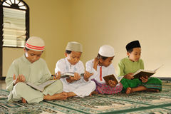 Islam Kids Reading Koran. Muslim Kids Reading Koran at Islamic school royalty free stock image