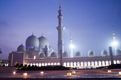 Islam in middle east. Walking to a mosque at sunset prayer in Abu Dhabi Royalty Free Stock Image