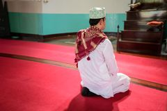 Islam muslim man in muslim praying. And  sit on red carpet in mosque Stock Photo