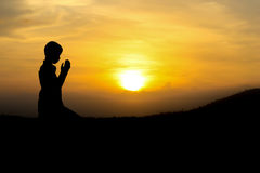 Islam. People praying at the sunset royalty free stock photo
