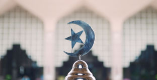 Islam symbol in front of the insude of Outra Mosque Royalty Free Stock Image