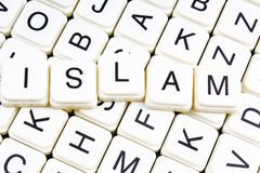 Islam text word crossword title caption label cover background. Alphabet letter toy blocks. White alphabetical letters. Islam Royalty Free Stock Photography