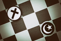 Islam vs Christianity. Draughts Checkers - Islam vs Christianity - religious tension and conflict between two monotheistic religions and believers, muslims and royalty free stock photography